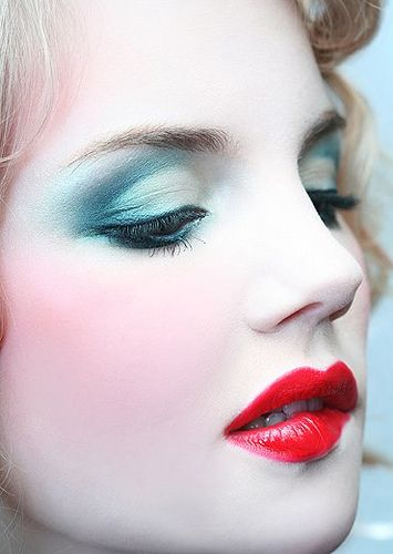This is what Alice's makeup would look like. The eye shadow matches her dress. Her skin would be pale because of the theme in Alice in Wonderland. All the other character's faces is white as well. I like that her lip stick color is bright and bold because it is not like the rest of her makeup. Her makeup is simple and pretty.