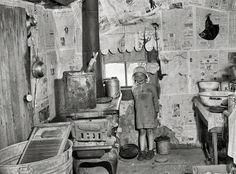 """May 1936. """"Kitchen of Ozarks cabin purchased for Lake of the Ozarks project. Missouri."""" Photo by Carl Mydans, Resettlement Administration."""