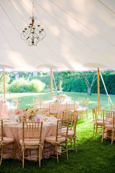 light pink reception tables with gold chairs under marquee tent http://www.itgirlweddings.com/blog/southampton-affair