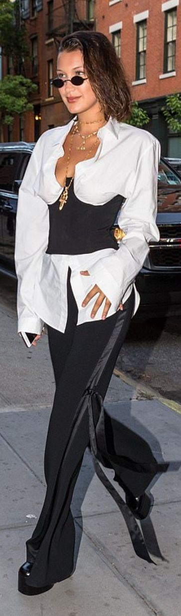 Bella Hadid' in Pants – Givenchy  Corset – Orseund  Sunglasses – Roberi & Fraud