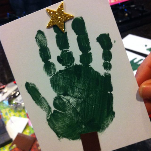 use your child's hand to make a Christmas tree card to go with a Christmas gift for a reacher
