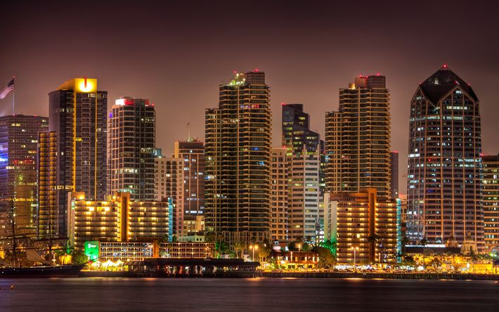 Download wallpapers San Diego, skyscrapers, evening, night, city lights, American flag, USA