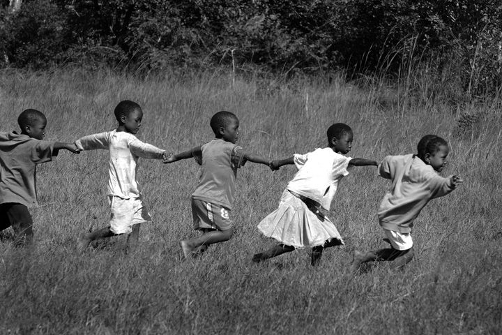 African Children Playing  AIDS: Picture Change.  Image Credit: Peter Bregg  PhotoSensitive's project, AIDS: Picture change, an international project led by CARE Canada began in 2005.