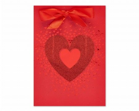 Wrap up your Valentine's gifts with this glitter heart print gift bag from Carlton Cards.