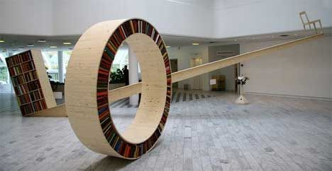 These two designs from David Garcia playfully twist our perceptions of reading. The first, Archive I, is a balanced library: the reader's chair is elevated, and the library has to be at least as heavy as the reader for the chair to remain in its heightened position. The round library, Archive II, is a throwback to the traveling libraries of days gone by: a simple concept that invites users to take their library with them as they explore the world with a book i