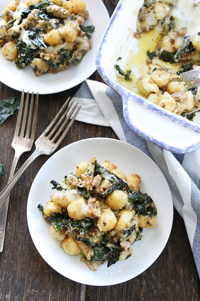Baked Gnocchi with Sausage, Kale, and Pesto Recipe on twopeasandtheirpod.com This easy and comforting baked gnocchi dish is a family favorite! Make it for dinner tonight!