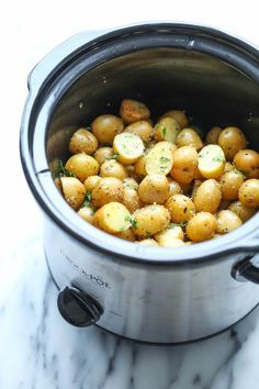 Slow Cooker Garlic Parmesan Potatoes - Crisp-tender potatoes with garlicky parmesan goodness. It's the easiest side dish you will ever make in the crockpot!