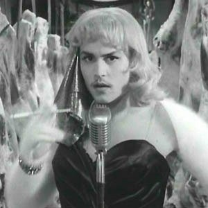 "Johnny Depp as cross-dressing director, Ed Wood, in the Tim Burton film titled ""Ed Wood"""