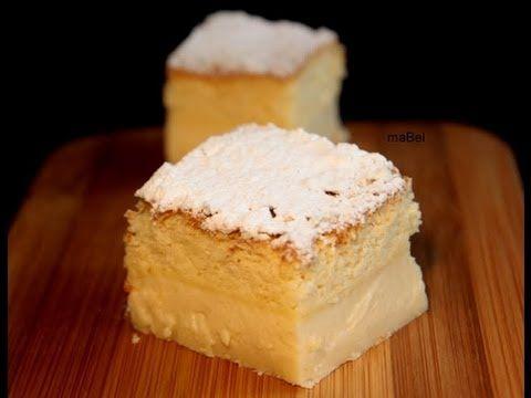 TARTA MAGICA / 4 huevos (separados yemas de claras). 1 cda agua . 150 gr de azúcar común. 125 gr de manteca o margarina. 115 gr de harina. 500 gr leche  ( medio litro). esencia de vainilla. azúcar glas para decorar