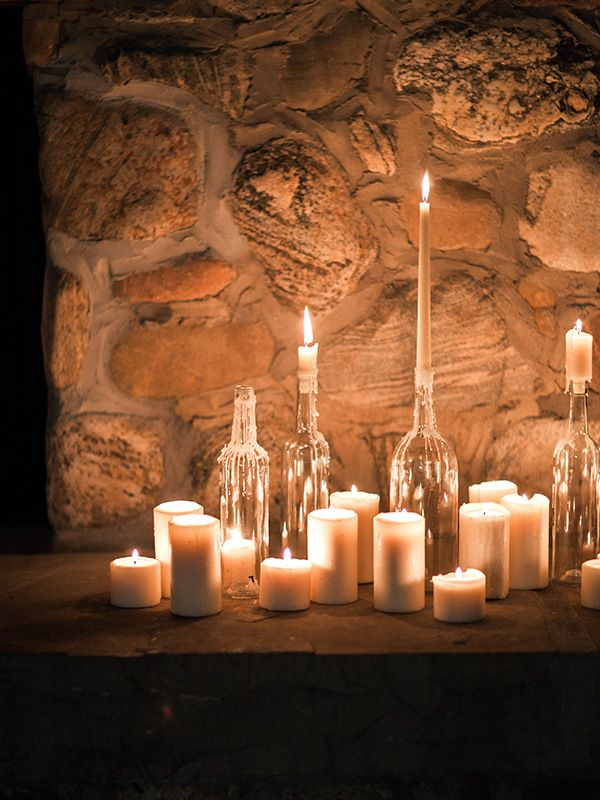 Clusters of Glowing Candles | Megan Robinson Photography and Leslie Dawn Events | Candlelight Winter Wedding Ideas in Green and White