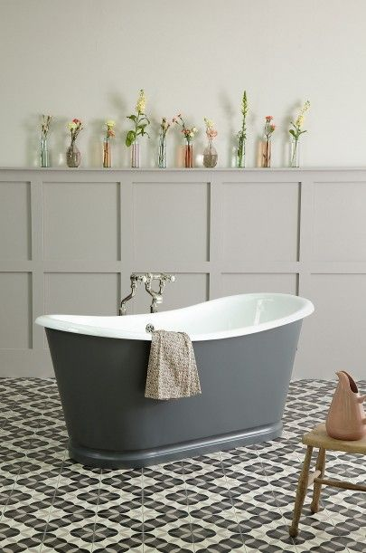 La Rochelle Cast Iron Bateau Bath painted in Farrow and Ball's 'Downpipe' set against pretty tearose tones