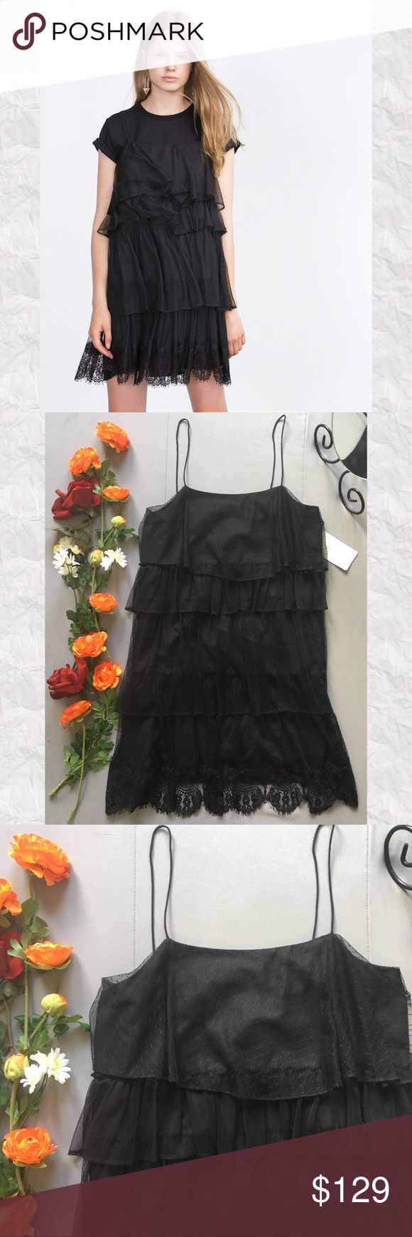 """Zara Ruffled Tiered Lace Mini Dress *SALE IS FOR DRESS ONLY! *Brand new with tags. See photos 5. *Looks great layered or alone.  *100% Nylon *Machine washable  *Popover style *Relaxed silhouette *Scalloped eyelash trim hen  *There is an additional 1"""" of Strap that can be let out at buyer's discretion see photo 9 *Measurements are approx & taken lying flat *Bust 36"""" *Shoulder to hem 32.5"""" *Stored in non-smoking pet free home Zara Dresses Mini"""