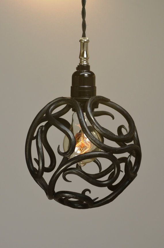 This 7 1/2 inch diameter pendant light is hand forged from steel round stock. It has an oil blackened finish, that is sealed with a lacquer clear coat. We use a phenolic socket for a vintage look, with nickel plated or antique brass fittings and oil blackened canopy. We include 5 feet of black braided or herringbone wire standard. The fixture takes an A-19 Edison bulb which is included. All components are UL listed and are tested prior to shipping.   All hardware is included. Due to the hand…