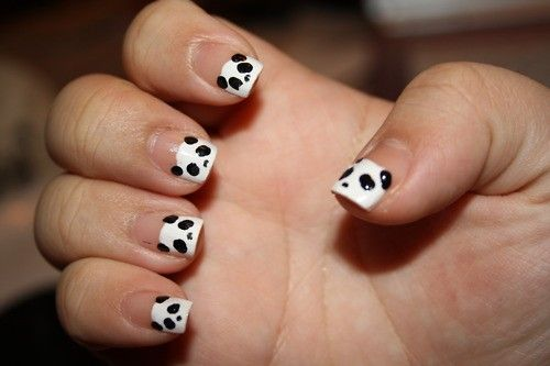 I did mine with white nail polish and a black detail nail pen. Very easy and looked wonderful!