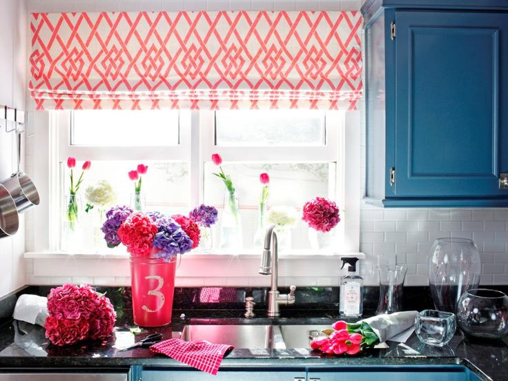 See how a lackluster kitchen gets a new, coastal-inspired look thanks to clever repurposing, use of color and punchy patterns.