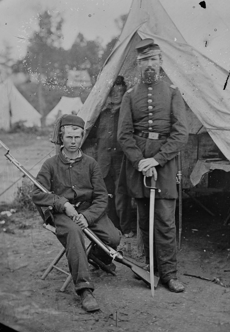 Captain Harrison H. Jeffords (right) and another young Union Zouave of the 4th Michigan Volunteer Infantry Regiment posing in front of a tent in an unidentified tent during the Civil War. Jeffords was mortally wounded at the Battle of Gettysburg. Attributed to Mathew Brady. Animated stereoscopic photographs.