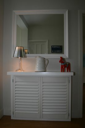 We love the shuttered front of this radiator cover.