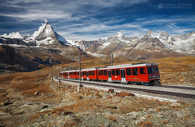 Red Swiss train in Gornergrat, Alps - Switzerland.