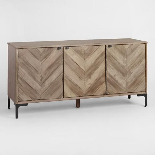 Alternating pieces of light and dark finished wood create a dimensional chevron pattern on our rustic storage cabinet. Featuring finger-pull latches for a clean look, it offers three shelves behind its doors - place in the dining room as a sideboard to store dinnerware or in the living room as a TV stand to organize media components.