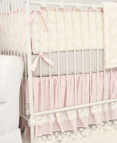 This 2 pc. set features a sweet classic taupe dot crib sheet and a gorgeous pink vintage lace double ruffle crib skirt. This crib bedding set will bring a look of elegance to any baby girl's nursery.