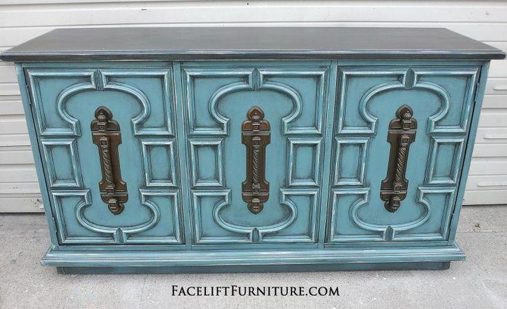 Sea Blue Vintage Cabinet with Black Glaze.  Distressing reveals heavy white primer.  Original pulls.