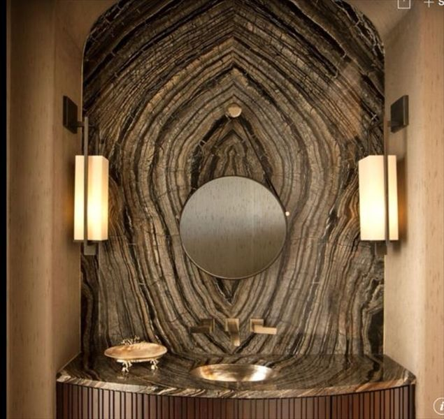 Silver Wave marble slab. This is a beautiful book-match installation in a powder bath. Quartzite is MUCH harder than Marble, or Onyx. You can view this and MANY other natural stone slabs on our website  www.umistone.com