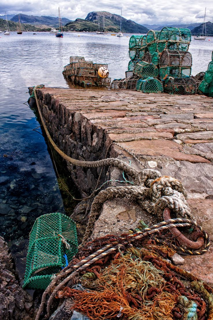 The slipway in Plockton leading down to Loch Carron with an assortment of lobster pots ready for that days fishing.
