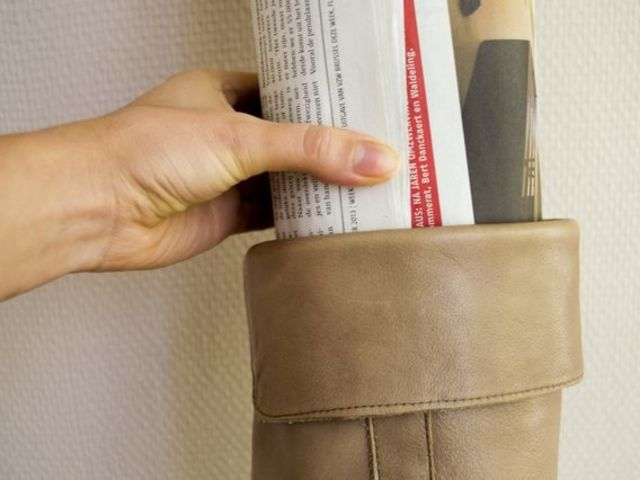 8. Widen the shafts of boots with leather stretch spray and newspaper.