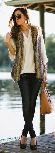 fur vest and dark denim look.  Fall Date Night Dressing | Divine Style