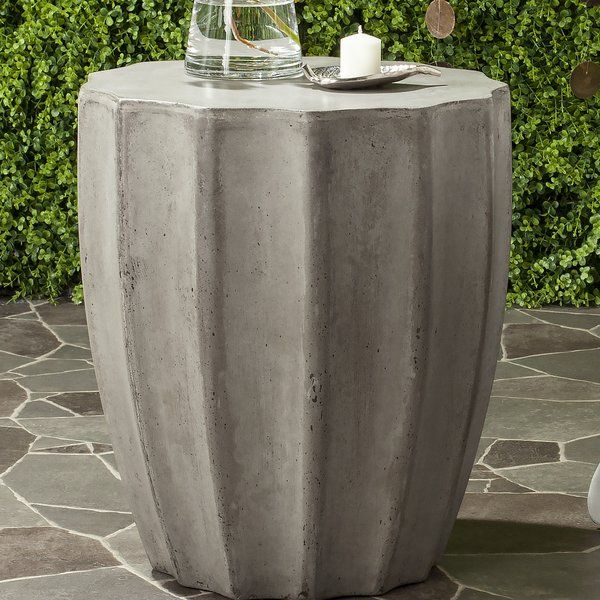 An exhibition of antiquity's architectural marvels at the world's top encyclopedic museum inspired this contemporary concrete accent table. Its nuanced design and hue highlight the symmetric ideal defining beauty in the ancient and modern world. Perfect for indoor and outdoor use.