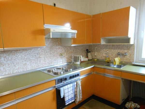 my childhood home originally had hideous orange cabinets like that too, but my mother had them all redone in the 90s.