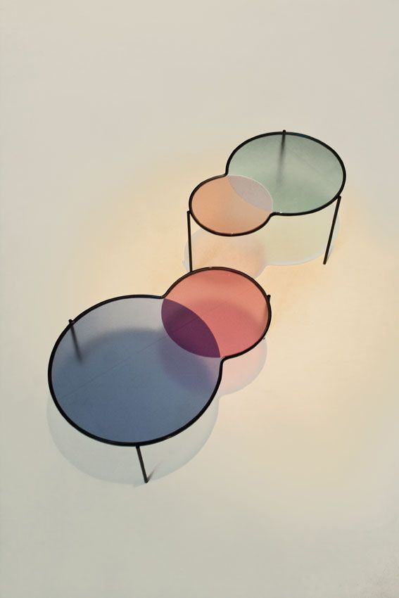 Swedish design studio Outofstock was inspired by the overlay of colors in venn diagrams, this set of nesting tables is composed of waterjet-cut low iron glass tops that are sandblasted and coloured.
