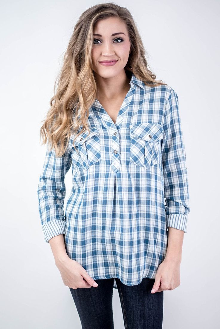 Roll up your sleeves and take on the day with our Blue Checkered Pocket Tunic! Pair with dress pants and heels for work or pair with denim and booties for a casual look for class or cutting down your seasonal Christmas tree at the tree farm! Blue Checkered Pocket Tunic - Single Thread Boutique, $36.00 #blue #checkered #pocked #tunic #classic #collar #high #low #hem #pockets #roll #up #sleeves #striped #lining #womens #fashion #winter #trendy #singlethreadbtq #shopstb #boutique