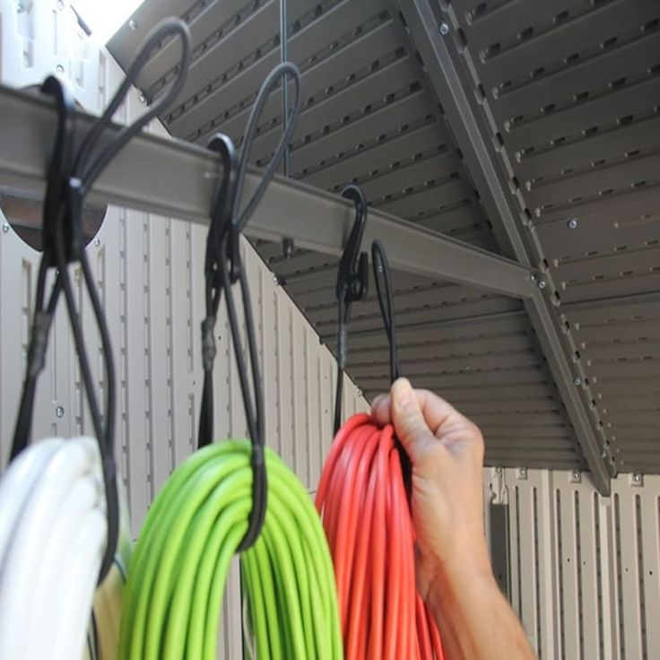 "Each bungee cord and nylon hook can hold up to 100' of cord or hose that weighs in as much as 50 lbs.Promising review: ""These are the handiest little cords for hanging things around the garage. I'm ordering some more. I hang things from my overhead storage racks like my climbing ropes, extension cords, and even things like extra motorcycle tires, backpacks, sawhorses, duffle bags, etc."" --Jimbobrian15Get a set of three for $19.97 (available in two colors)."