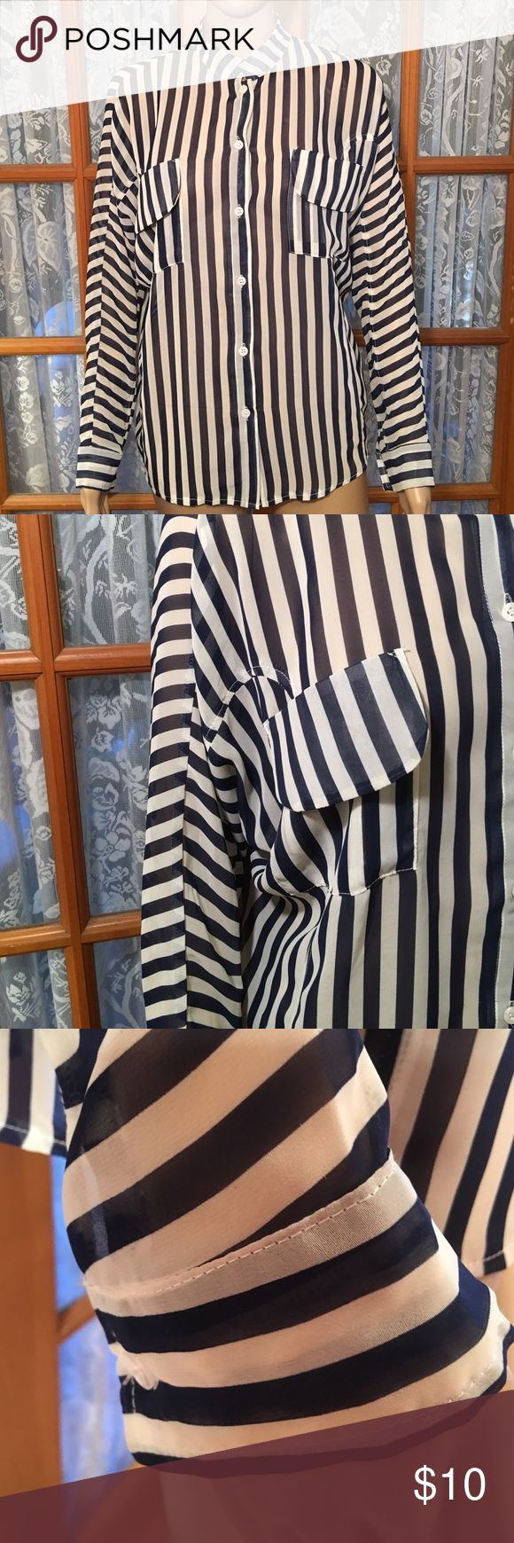 "UmGee USASheer Navy Blue & White LS Top Really nice oversized small sheer top. 2 chest pockets. Button sleeves. Bust is 46"". Length is 25"". Sleeves are batwing. It is in excellent condition and comes from my non smoking home. umGhee Tops Button Down Shirts"