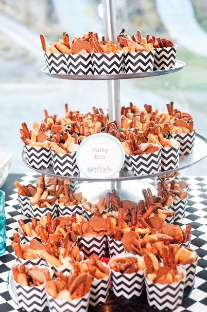 cute party cups filled with inexpensive party mix = great presentation on a budget