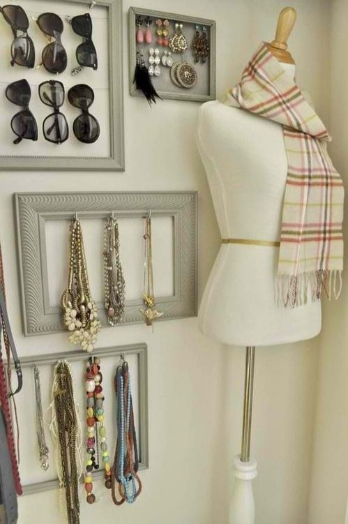 I love the use of empty picture frames!  Makes the jewelry look like pieces of art.