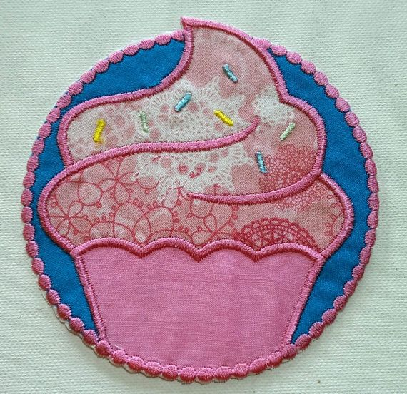 Machine Embroidered Iron On Cupcake Patch/ applique  Like to do it yourself? These cute applique patches are an easy and adorable way to personalize shirts, jeans, bags, Iron onto a shirt for a great boutique look!  Easy application instructions are included with your patch. I add HeatnBond Ultra heat to the back of my designs, For clothing or items to be washed I do recommend you sew around the design with a zig-zag or straight stitch by machine or hand.   Approx 6 high Please note: Al...