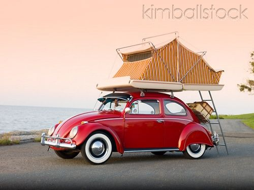 1964 Volkwagen Beetle Red With Topper Tent 3/4 Front View On Pavement By Ocean
