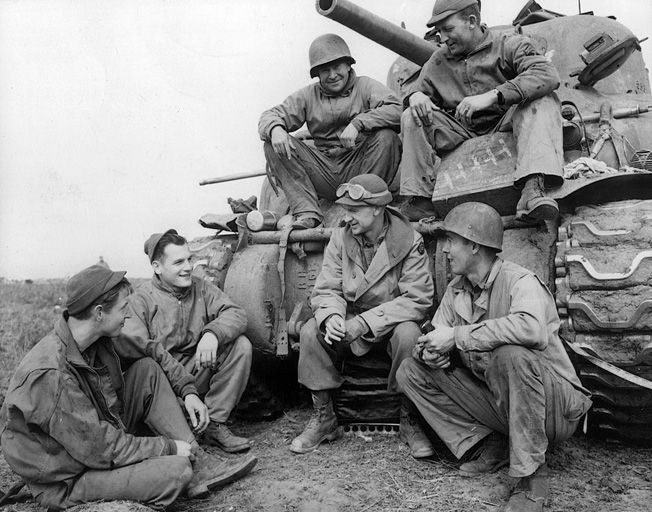During a lull in the fighting at the Anzio beachhead, Ernie Pyle visits with a tank crew of the 191st Tank Battalion.