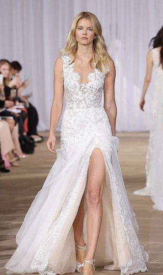 Gorgeous Ines Di Santo layered lace and organza wedding gown. This A-line dress is so beautiful -- Love the scalloped décolleté neckline, illusion back and a leg-flaunting slit cut high on the thigh.
