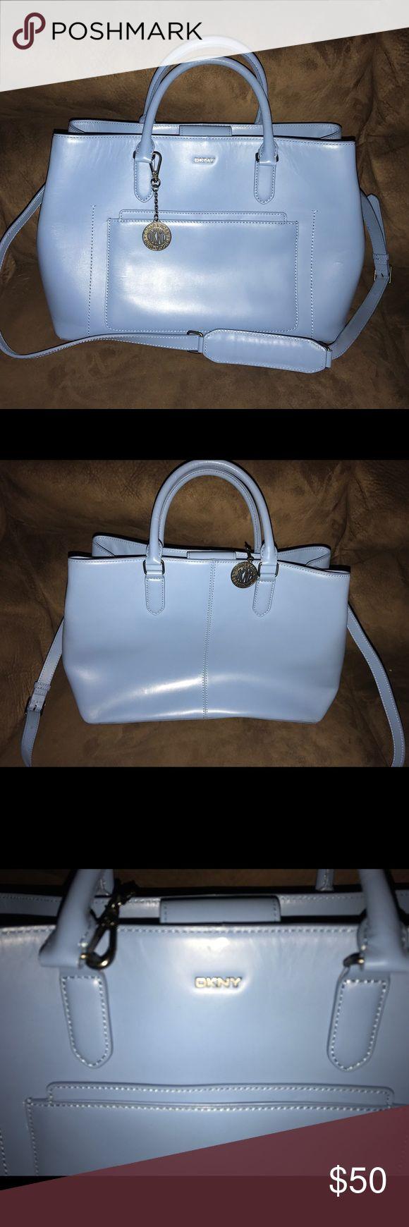 DKNY Handbag DKNY Handbag. NWOT. Very pretty soft blue. Has never been used. Has nice middle zipper pocket for lots of storage. DKNY Bags