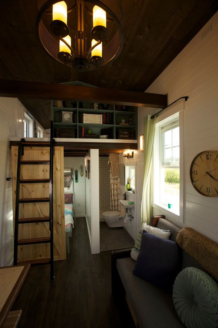 Expandable Tiny Cottage – Tiny House Swoon. A 325 square feet tiny house with folding deck and retractable and expanding wall that can sleep seven people in Liberty Lake, Washington.