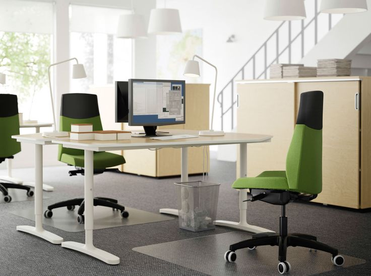 a workspace with bekant desks in birch and white and wolmar working chairs in green office. Black Bedroom Furniture Sets. Home Design Ideas