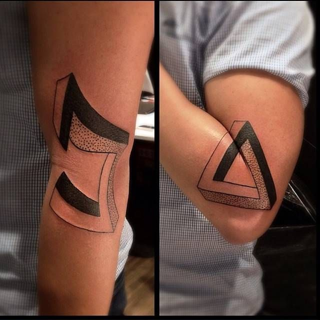 Matching penrose tattoo on the left arm.