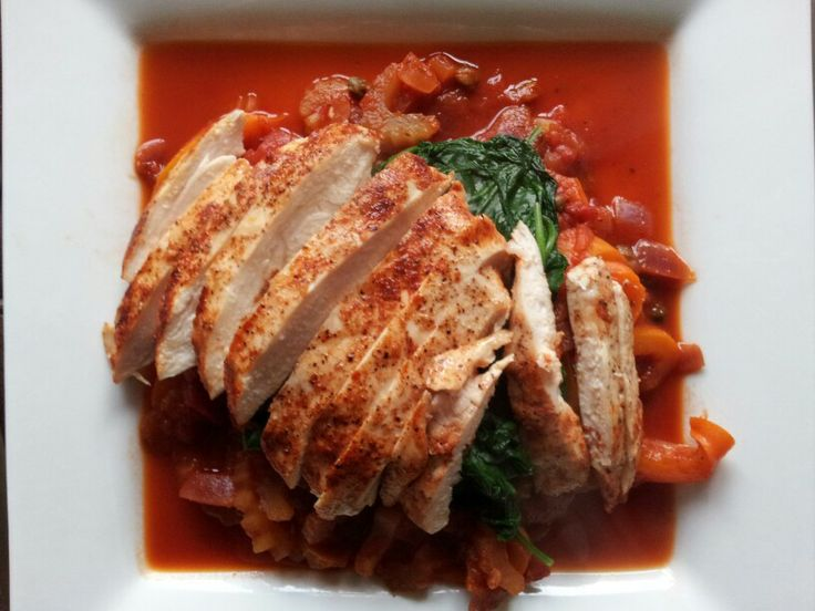 Paprika chicken with spinach and tomato caponata.