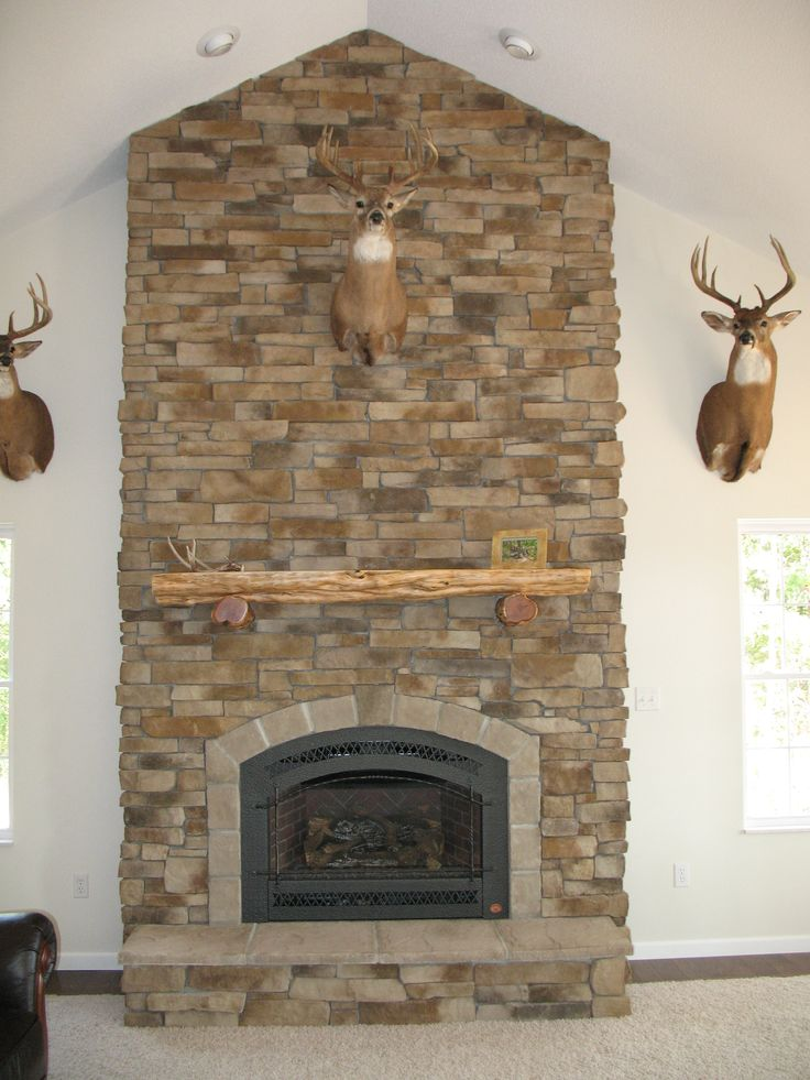Show off your trophy on a dry-stack cultured stone veneered fireplace. - 17 Best Ideas About Stacked Stone Fireplaces On Pinterest Stone