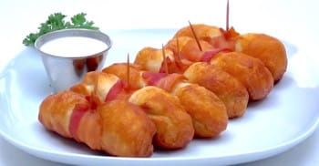 Bacon is not only one of my favorite foods, but it is a great way to give any ordinary dish a delicious upgrade. There are so many amazing bacon recipes out there, like these BBQ bacon meatball onion bombs. And I've now come across an incredible appetizer that will put a smile on any bacon lover's... View Article