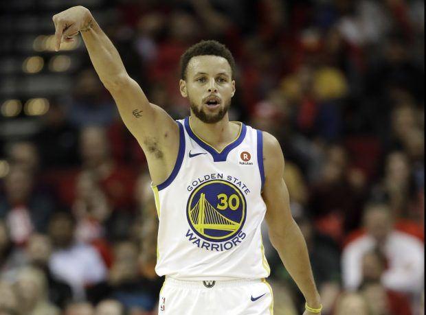 Golden State Warriors' Stephen Curry reacts after making a 3-point basket during the second half of an NBA basketball game against the Houston Rockets Thursday, Jan. 4, 2018, in Houston. The Warriors won 124-114.(AP Photo/David J. Phillip)