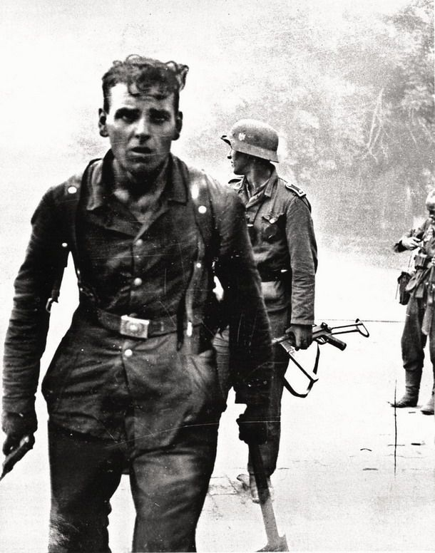 German soldiers fighting in Novorossiysk, Russia, in 1943. That's the face of a man who has seen hell.